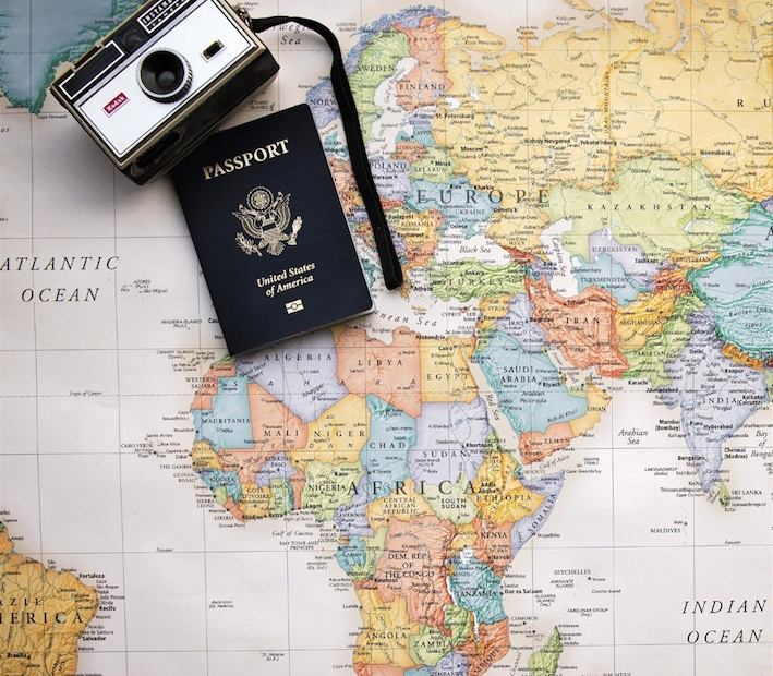 World map with camera and passport