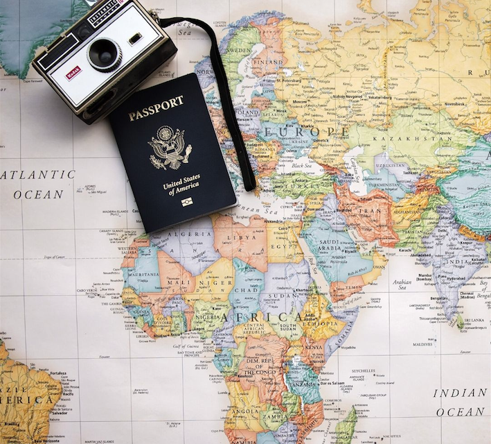 Map of world with camera and passport