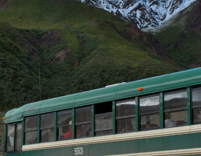 A bus driving in the Mountains